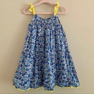 Mini Boden blue floral top yellow ties & pompom